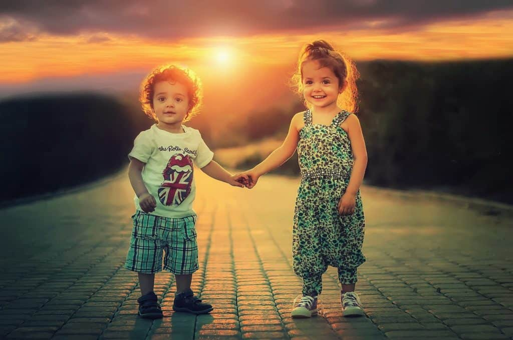 Image of happy children smiling in the sunset, because of their NJ child support